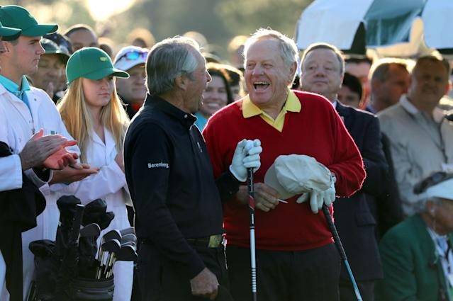 Honorary starters Gary Player of South Africa (L) and Jack Nicklaus of the U.S. share a laugh before teeing off during the ceremonial start before first round play in the 2018 Masters golf tournament at the Augusta National Golf Club in Augusta, Georgia, U.S. April 5, 2018. REUTERS/Lucy Nicholson