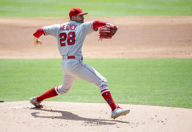 Los Angeles Angels starting pitcher Andrew Heaney (28) works against the Texas Rangers during the first inning of the first baseball game of a doubleheader Tuesday, Aug. 20, 2019, in Arlington, Texas. (AP Photo/Jeffrey McWhorter)