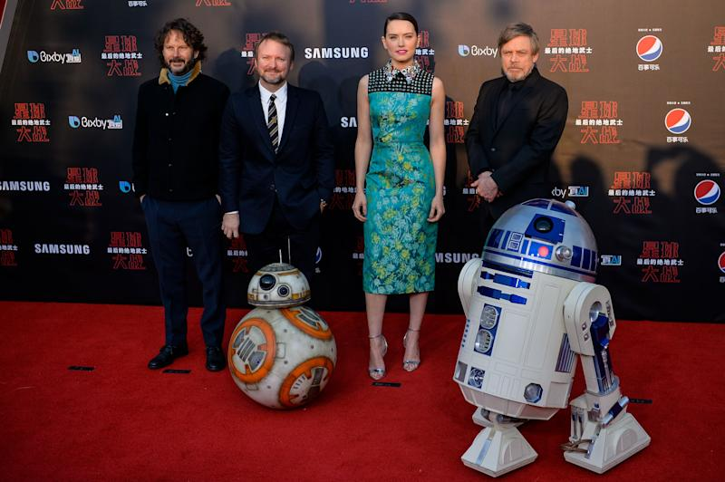 L-R Israeli film producer Ram Bergman, US film director Rian Johnson, British actress Daisy Ridley, US actor Mark Hamill pose at the red carpet for the Chinese premiere of 'Star Wars: The Last Jedi' at the Shanghai Disney Resort in Shanghai on December 20, 2017. / AFP PHOTO / CHANDAN KHANNA (Photo credit should read CHANDAN KHANNA/AFP via Getty Images)
