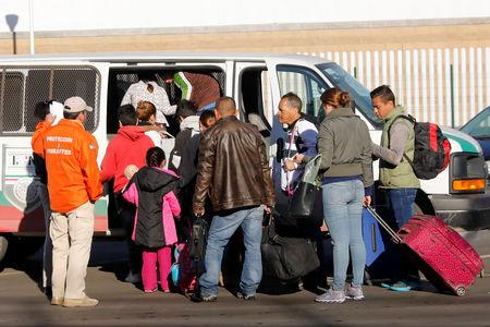 FILE PHOTO: People enter an immigration van at the Chaparral border into the United States in Tijuana, Mexico, January 26, 2019. REUTERS/Shannon Stapleton
