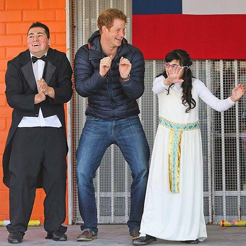 """On his summer 2014 South American tour, we found <a href=""""/tag/prince-harry/"""">Prince Harry</a> hard to resist as he showed off <a href=""""/people/package/gallery/0,,20395222_20623561_21204052,00.html"""">those signature dance moves</a> at a daycare center in Santiago, Chile."""