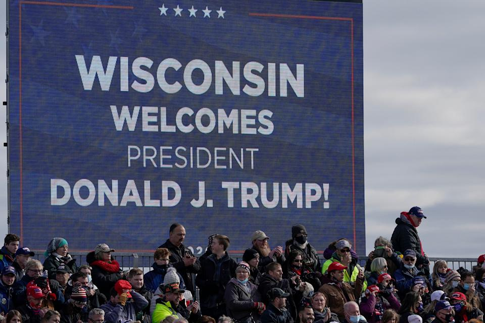 Supporters wait for President Donald Trump to speak at an Oct. 30 campaign rally at the Austin Straubel Airport in Green Bay, Wisconsin. (Photo: AP Photo/Morry Gash)