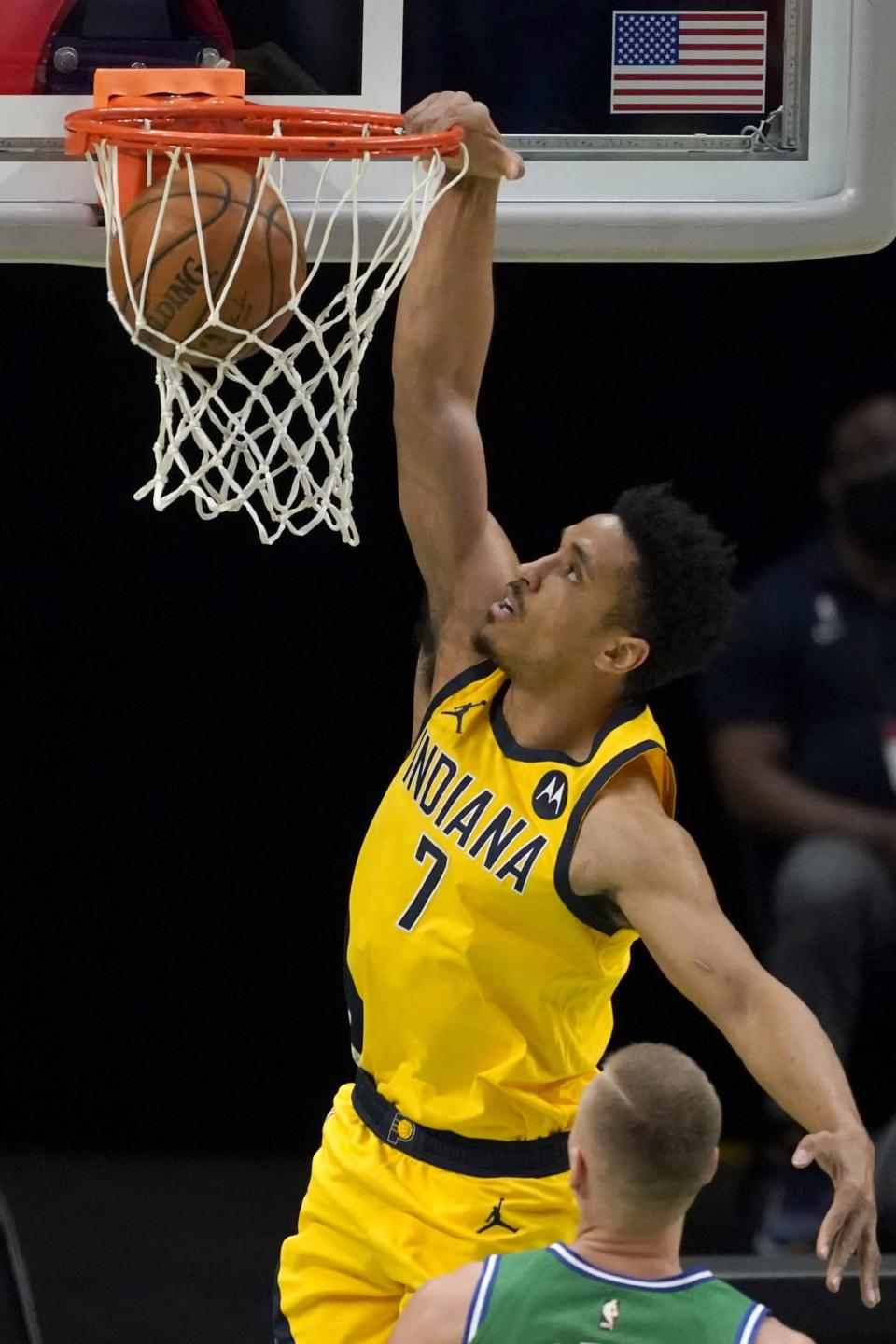 Indiana Pacers guard Malcolm Brogdon dunks during the first half of the team's NBA basketball game against the Dallas Mavericks in Dallas, Friday, March 26, 2021. (AP Photo/Tony Gutierrez)