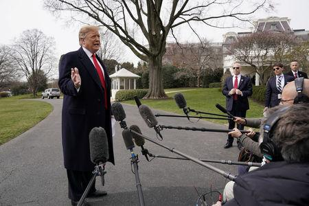 U.S. President Donald Trump talks to reporters as he departs on travel to Ohio at the White House in Washington, U.S., March 20, 2019. REUTERS/Kevin Lamarque