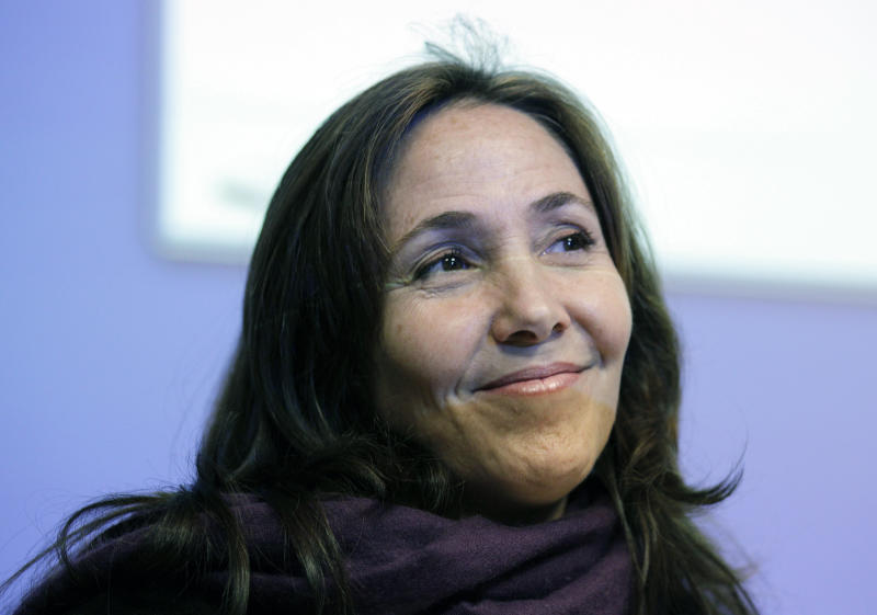 FILE - In a Wednesday, May 23, 2012 file photo, Mariela Castro, daughter of Cuban President Raul Castro, smiles before speaking to an academic conference at San Francisco General Hospital in San Francisco. Officials at the Equality Forum say Mariela Castro will attend the group's annual conference on gay rights this weekend.  The organization's executive director, Malcolm Lazin, said Tuesday, April 30, 2013 that the U.S. State Department reversed its initial decision denying a visa for Mariela Castro's visit.  (AP Photo/Eric Risberg, File)
