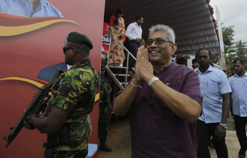Sri Lankan presidential candidate and former defense chief Gotabaya Rajapaksa greets the gathering as he leaves after addressing an election rally in Neluwa village in Galle, Sri Lanka, Tuesday, Oct. 22, 2019. The daughter of a Sri Lankan journalist assassinated during the country's civil war says she'll appeal a U.S. court's decision to throw out her lawsuit against Rajapaksa, the front-runner in Sri Lanka's upcoming presidential election. Rajapaksa was defense chief when Lasantha Wickrematunge, editor of the Sunday Leader newspaper, was killed in January 2009, around four months before the end of the long civil war. (AP Photo/Eranga Jayawardena)
