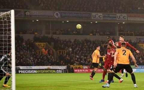 Jordan Henderson makes it 1-0 to Liverpool - Credit: Getty Images