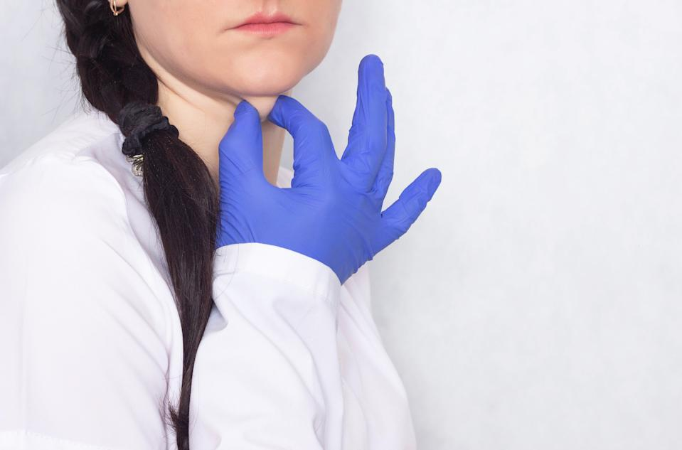 Plastic surgeon delays the girl's double chin, white background, medical, copy space, problems