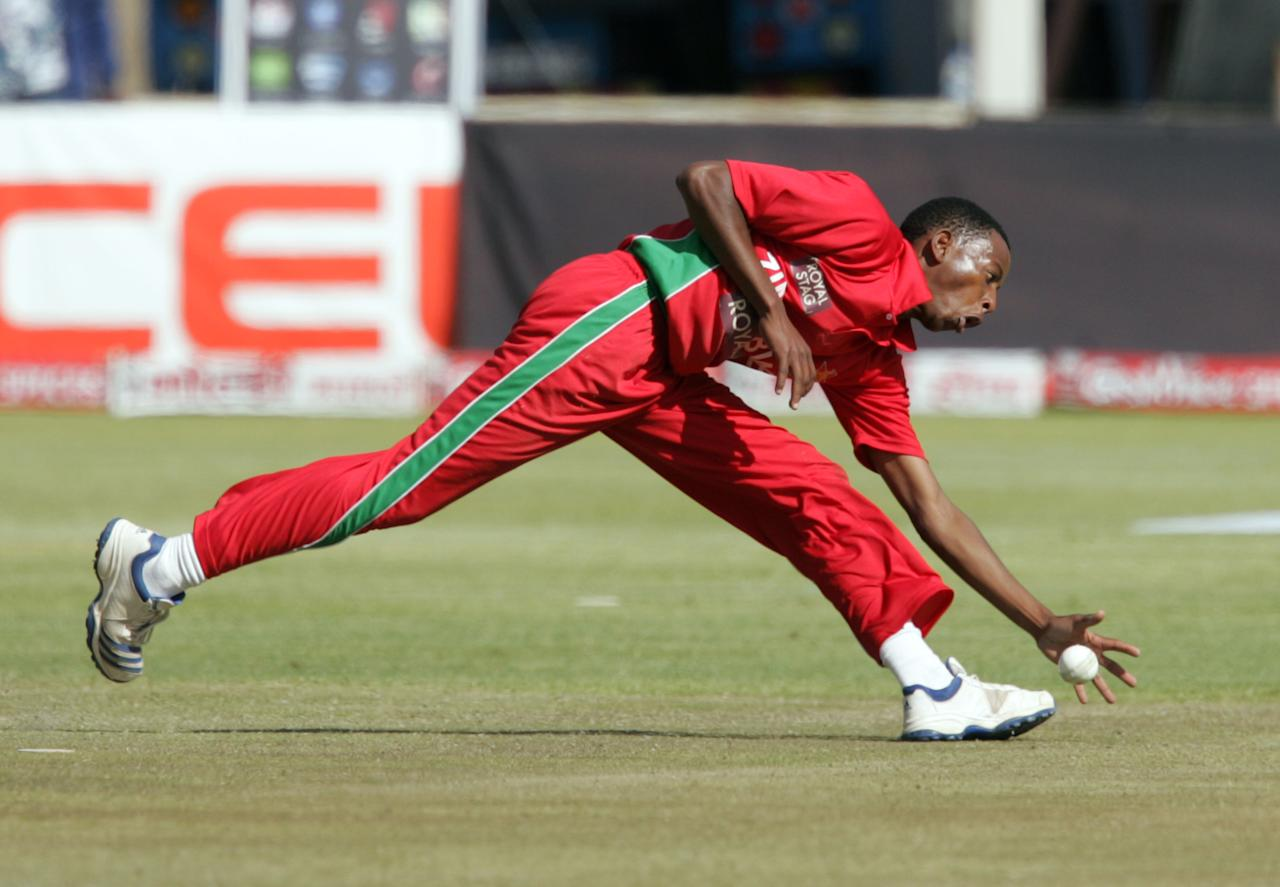 Zimbabwe's bowler Tinotenda Matopodza catches the ball during the final game of the 5 cricket ODI series matches between Zimbabwe and India at Queens Sports Club on August 3, 2013 in Harare.    AFP PHOTO Jekesai Njikizana.        (Photo credit should read JEKESAI NJIKIZANA/AFP/Getty Images)