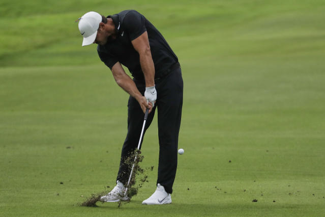 Brooks Koepka hits form the fairway on the 18th hole during the second round of the World Golf Championship-FedEx St. Jude Invitational Friday, July 31, 2020, in Memphis, Tenn. (AP Photo/Mark Humphrey)