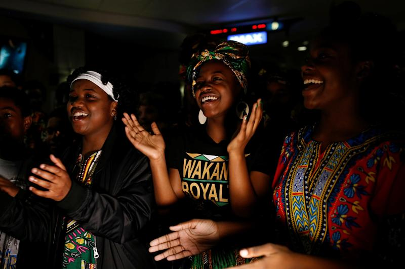 "Ron Clark Academy seventh-grader Nevaeh Williams, center, joins classmates in singing a song after watching ""Black Panther."""
