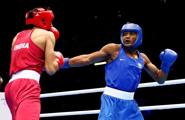 LONDON, ENGLAND - JULY 30:  Sumit Sangwan of India (L) in action with Yamaguchi Falcao Florentino of Brazil during their Men's Heavy (81kg) Boxing on Day 3 of the London 2012 Olympic Games at ExCeL on July 30, 2012 in London, England.  (Photo by Scott Heavey/Getty Images)