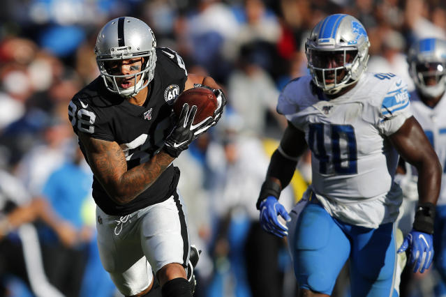 Oakland Raiders wide receiver Marcell Ateman (88) runs in front of Detroit Lions middle linebacker Jarrad Davis (40) during the second half of an NFL football game in Oakland, Calif., Sunday, Nov. 3, 2019. (AP Photo/John Hefti)