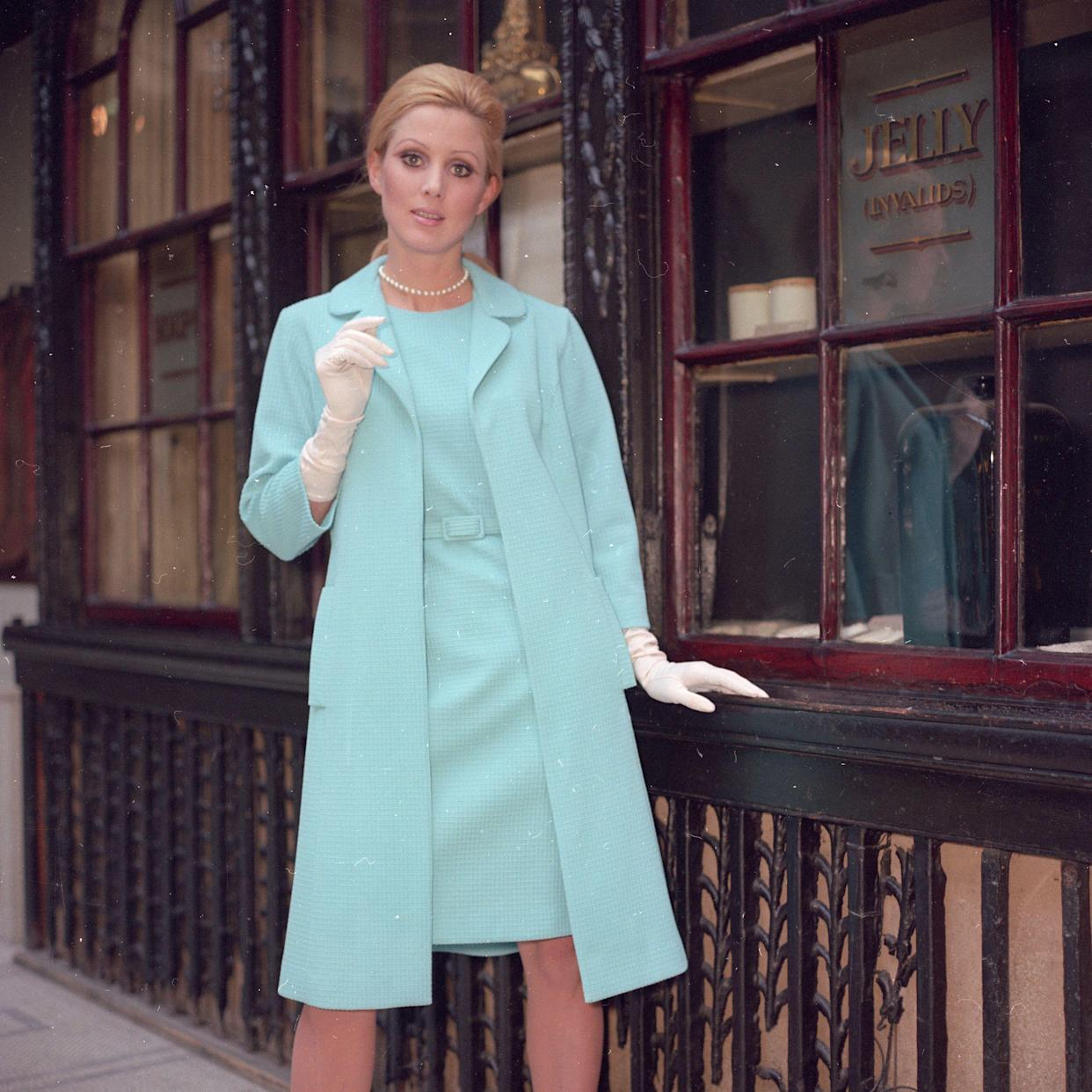 7th July 1969: Ice blue shift dress worn with a loose-fitting coat and long white gloves.