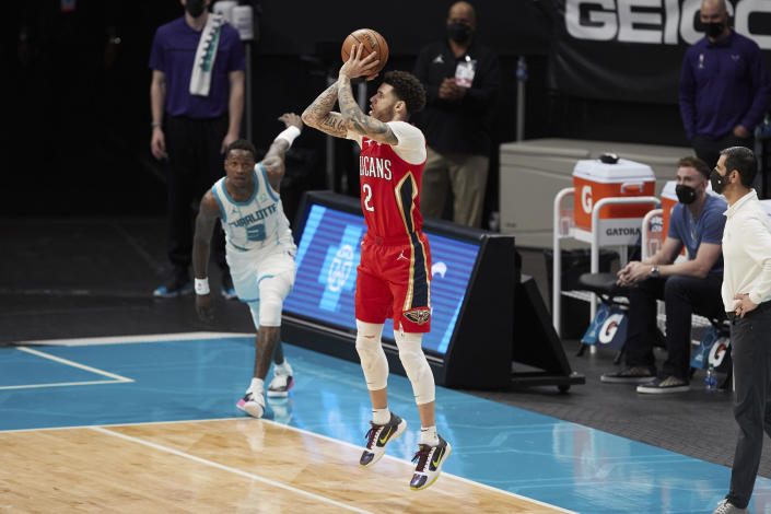 New Orleans Pelicans guard Lonzo Ball (2) attempts a 3-point shot during the second half of the team's NBA basketball game against the Charlotte Hornets on Sunday, May 9, 2021, in Charlotte, N.C. (AP Photo/Brian Westerholt)