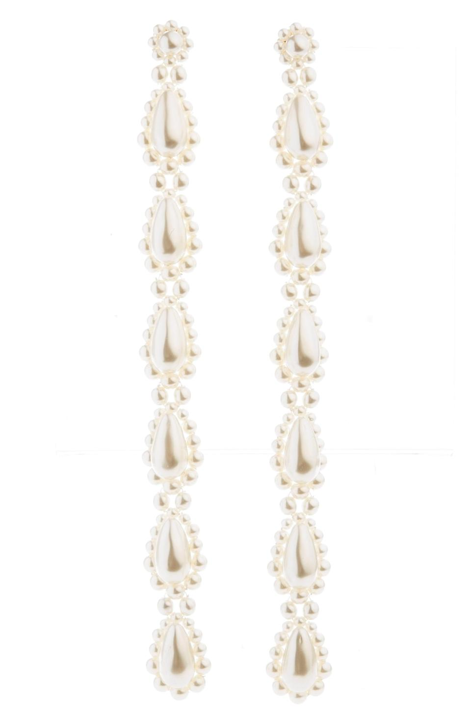 """<p><strong>Simone Rocha</strong></p><p>nordstrom.com</p><p><strong>$410.00</strong></p><p><a href=""""https://go.redirectingat.com?id=74968X1596630&url=https%3A%2F%2Fwww.nordstrom.com%2Fs%2Fsimone-rocha-long-faux-pearl-earrings%2F5740238&sref=https%3A%2F%2Fwww.harpersbazaar.com%2Ffashion%2Ffashion-week%2Fg34041265%2Fspring-2021-jewelry-trends%2F"""" rel=""""nofollow noopener"""" target=""""_blank"""" data-ylk=""""slk:Shop Now"""" class=""""link rapid-noclick-resp"""">Shop Now</a></p><p>White haute.</p>"""