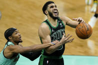 Charlotte Hornets guard Devonte' Graham fouls Boston Celtics forward Jayson Tatum during the second half of an NBA basketball game on Sunday, April 25, 2021, in Charlotte, N.C. (AP Photo/Chris Carlson)