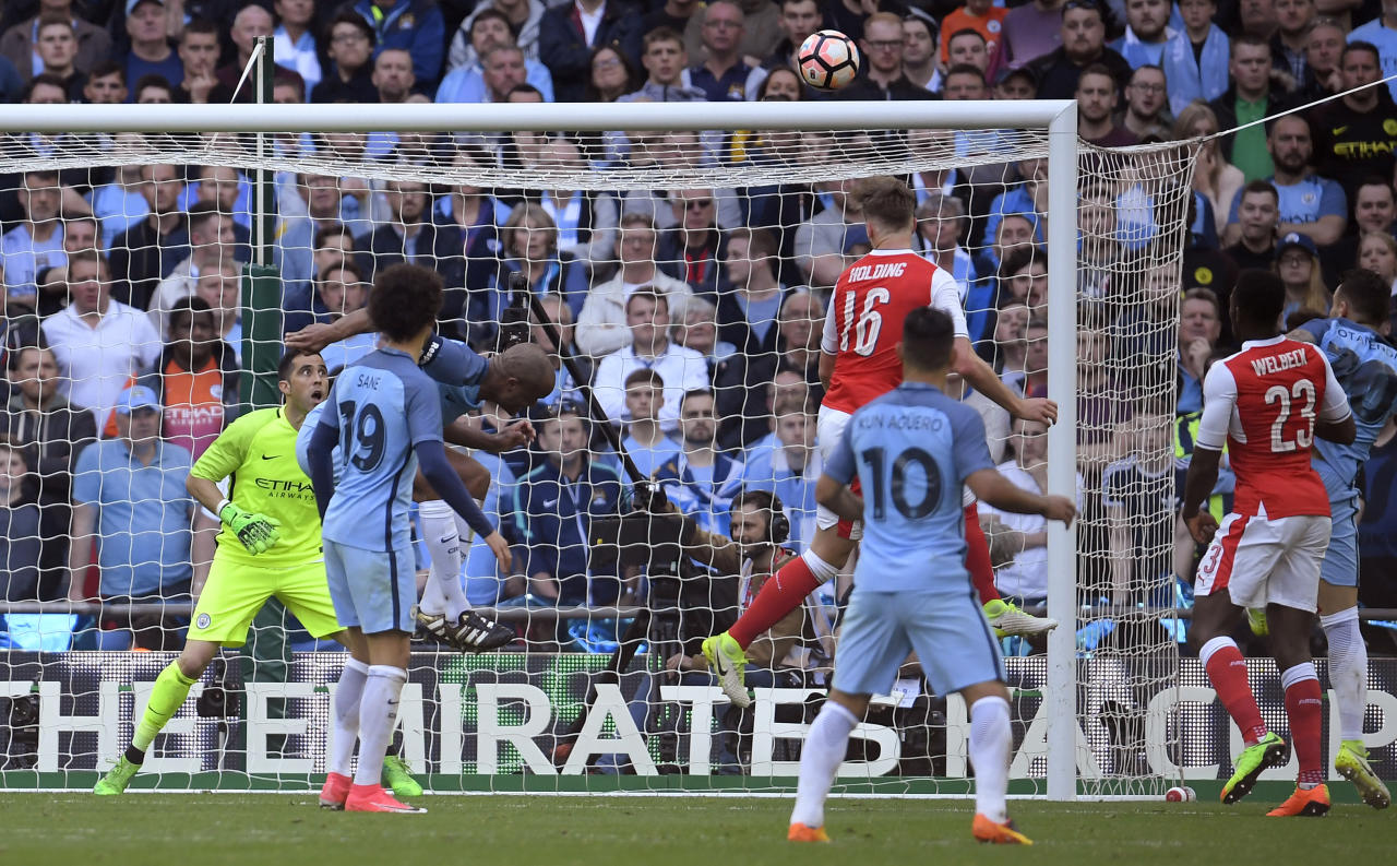 "Britain Football Soccer - Arsenal v Manchester City - FA Cup Semi Final - Wembley Stadium - 23/4/17 Arsenal's Rob Holding misses a chance to score as Manchester City's Claudio Bravo looks on Reuters / Toby Melville Livepic EDITORIAL USE ONLY. No use with unauthorized audio, video, data, fixture lists, club/league logos or ""live"" services. Online in-match use limited to 45 images, no video emulation. No use in betting, games or single club/league/player publications.  Please contact your account representative for further details."