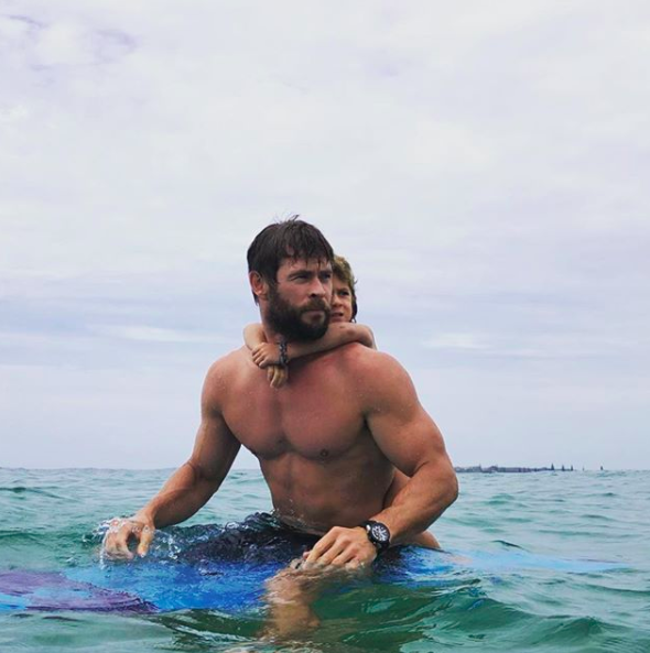 <p>Chris Hemsworth just being his hot self at the beach.</p>