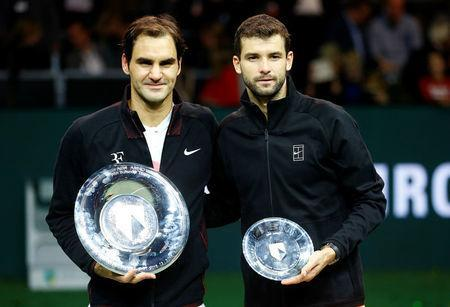 Tennis - ATP 500 - Rotterdam Open - Final - Ahoy , Rotterdam, Netherlands - February 18, 2018 - Roger Federer of Switzerland and Grigor Dimitrov of Bulgaria hold their trophies. REUTERS/Michael Kooren