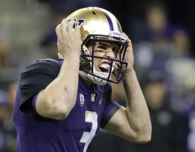 Washington quarterback Jake Browning calls to his team at the line of scrimmage during the first half of an NCAA college football game against Arizona State, Saturday, Sept. 22, 2018, in Seattle. (AP Photo/Ted S. Warren)
