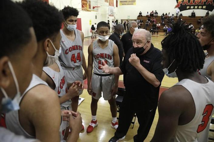 LOS ANGELES, CA - MAY 22, 2021 - - Westchester High School's varsity basketball coach Ed Azzam talks to his team before their game against Fairfax High School at Fairfax High School in Los Angeles on May 22, 2021. (Genaro Molina / Los Angeles Times)