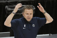 FILE - Washington Wizards head coach Scott Brooks gestures during the second half of an NBA basketball game against the Charlotte Hornets in Washington, in this Sunday, May 16, 2021, file photo. Scott Brooks is out as coach of the Washington Wizards, said a person with knowledge of the situation. The person spoke to The Associated Press Wednesday, June 16, 2021, on condition of anonymity because the team hadn't publicly announced the decision. (AP Photo/Nick Wass, File)