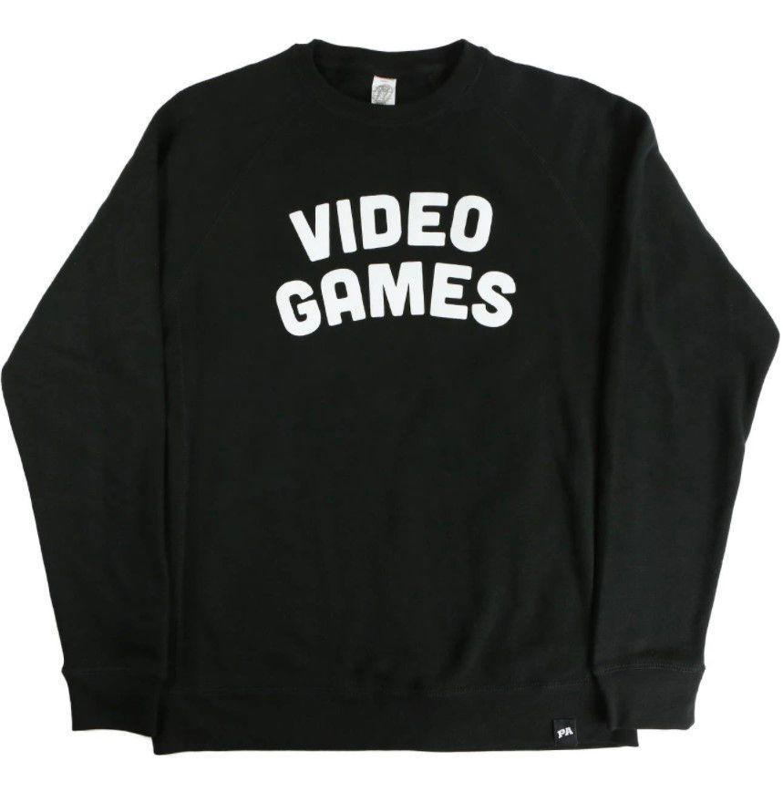 """<p><strong>Penny Arcade</strong></p><p>penny-arcade.com</p><p><strong>$45.00</strong></p><p><a href=""""https://store.penny-arcade.com/products/video-games-crewneck-black"""" rel=""""nofollow noopener"""" target=""""_blank"""" data-ylk=""""slk:Buy"""" class=""""link rapid-noclick-resp"""">Buy</a></p><p>Straightforward. To the point. No reason to be coy about it.</p>"""