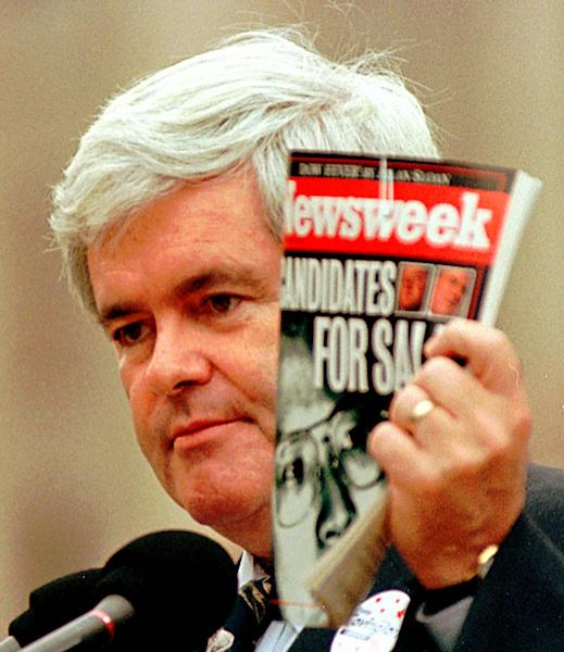 FILE - In this Thursday, Oct. 24, 1996 file photo, House Speaker Newt Gingrich, R-Ga., holds a copy of Newsweek Magazine and makes comments about President Clinton and the Democratic party in Jackson, Miss. Newsweek announced Thursday, Oct. 18, 2012 that it will end its print publication after 80 years and shift to an all-digital format in early 2013. Its last U.S. print edition will be its Dec. 31 issue. The paper version of Newsweek is the latest casualty of a changing world where readers get more of their information from websites, tablets and smartphones. It's also an environment in which advertisers are looking for less expensive alternatives online. (AP Photo/Dan Loh, File)