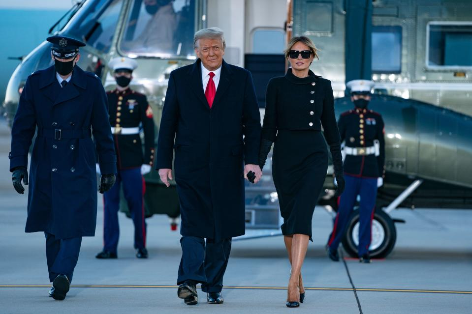 Outgoing US President Donald Trump and First Lady Melania Trump step out of Marine One at Joint Base Andrews in Maryland on January 20, 2021. - President Trump and the First Lady travel to their Mar-a-Lago golf club residence in Palm Beach, Florida, and will not attend the inauguration for President-elect Joe Biden.