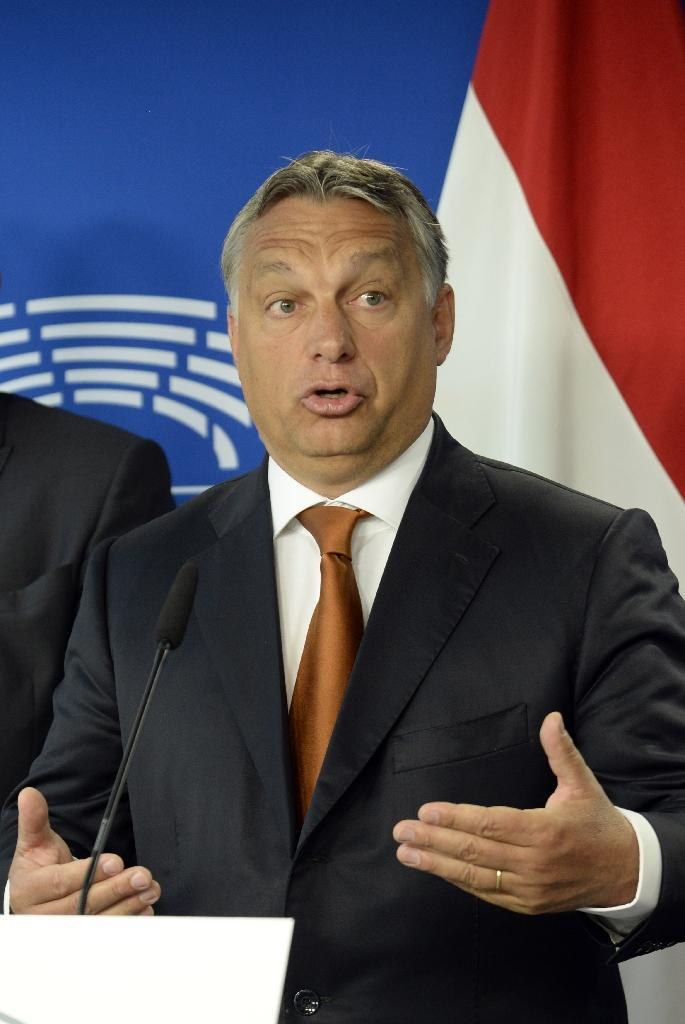 Hungary's Prime Minister Viktor Orban gives a press conference prior to his meeting with EU officials on the response to the migrant crisis at the European Union council building in Brussels, September 3, 2015 (AFP Photo/Thierry Charlier)