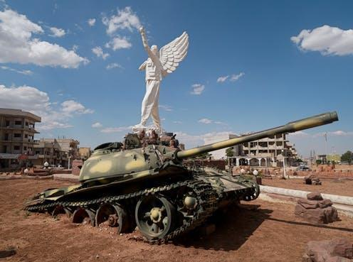 "<span class=""caption"">An Islamic State tank beneath a statue of a Kurdish fighter in Kobanî, northern Syria</span> <span class=""attribution""><span class=""source"">Elise Marie Boyle Espinosa</span>, <span class=""license"">Author provided</span></span>"