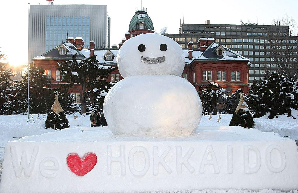 A snowman stands at the Hokkaido Government Office Building for Sapporo Snow Festival 2008.