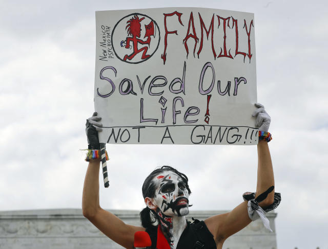 "<p>Fonz Tobin, 25, from Albuquerque, N.M., holds up a sign in front of the Lincoln Memorial in Washington, as he joins other supporters of the rap group Insane Clown Posse, during a rally Saturday, Sept. 16, 2017, to protest and demand that the FBI rescind its classification of the juggalos as ""loosely organized hybrid gang."" (Photo: Pablo Martinez Monsivais/AP) </p>"