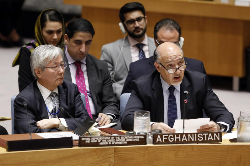 United Nations envoy for Afghanistan Tadamichi Yamamoto, left, listens as Afghanistan's U.N. Ambassador Mahmoud Saikal addresses the United Nations Security Council, at U.N. headquarters, Monday, Sept. 17, 2018. (AP Photo/Richard Drew)
