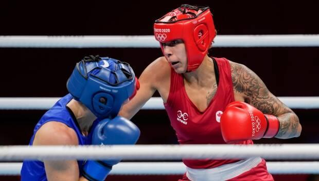 Canada's Tammara Thibeault, right, fights Netherlands' Nouchka Fontijn during their women's middleweight 75-kg boxing match at the 2020 Summer Olympics, Saturday, July 31, 2021, in Tokyo, Japan. (AP Photo/Themba Hadebe - image credit)
