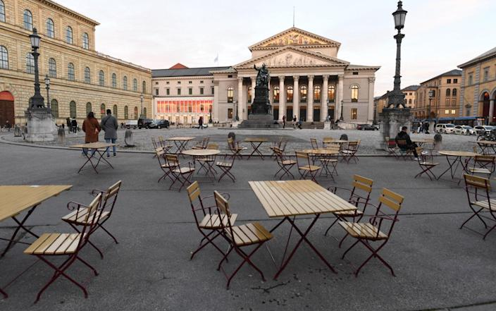 MUNICH, GERMANY - OCTOBER 31: Empty chairs and tables stand outside a restaurant in front of the opera house where wearing masks is mandatory during the second wave of the coronavirus pandemic on October 31, 2020 in Munich, Germany. The German government recently announced that effective this coming Monday, November 2, all restaurants, bars, cultural venues, cinemas, fitness studios and sports halls must close for four weeks in an effort to rein in the skyrocketing growth in the number of daily infections that recently reached 18,000. Stores, schools and day care centers will remain open. (Photo by Andreas Gebert/Getty Images) - Andreas Gebert/Getty Images Europe