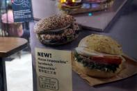 FILE PHOTO: A poster showing product from plant-based burger maker Impossible foods been using at Starbucks, in Hong Kong