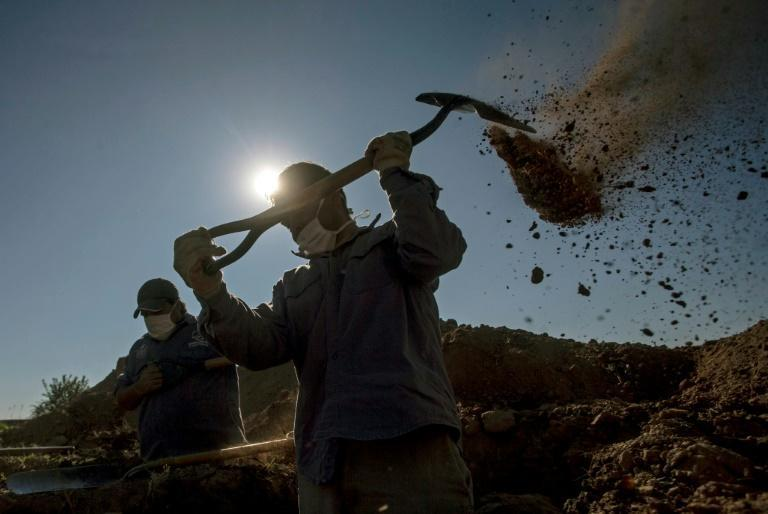 Cemetery workers dig graves at the San Vicente cemetery in Cordoba, Argentina in April 2021 amid the coronavirus pandemic