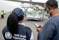 FILE PHOTO: WHO officials attend the arrival of the first batch of vaccines against the COVID-19, in Kigali