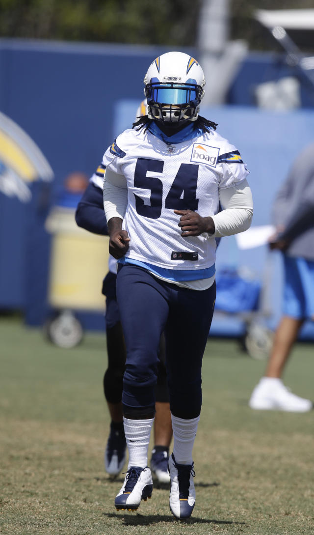 Los Angeles Chargers' Melvin Ingram warms up during practice at the NFL football team's minicamp Thursday,June 14, 2018, in Costa Mesa, Calif. (AP Photo/Chris Carlson)
