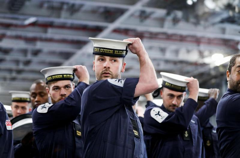 Royal Navy ratings practice in the hanger of HMS Queen Elizabeth ahead of her commissioning ceremony (PA)