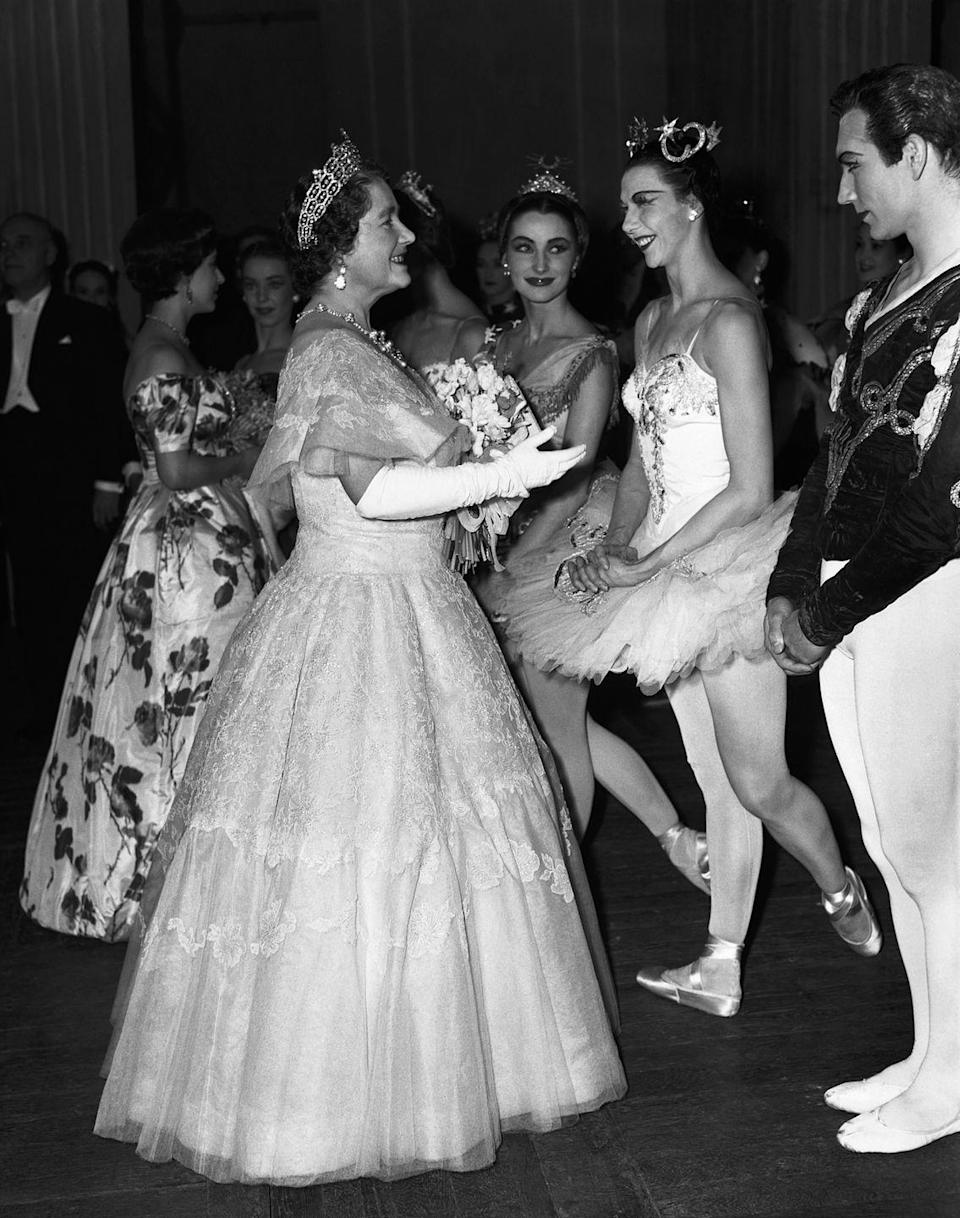 <p>The Queen Mother speaks with dancers after a 1939 gala performance at the Royal Opera House.</p>