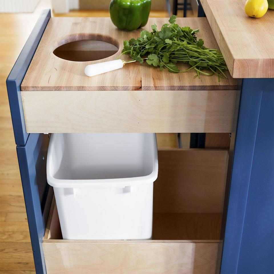<p>If you're short on counter space, build a butcher board into a drawer and carve out a whole in the middle to allow any food scraps to fall straight into the trash. </p>