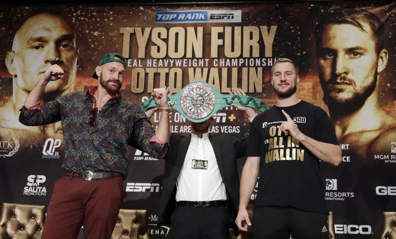 Tyson Fury, left, and Otto Wallin, of Sweden, pose for photos following a news conference Wednesday, Sept. 11, 2019, in Las Vegas. The pair will face each other in a heavyweight boxing match Saturday. (AP Photo/Isaac Brekken)