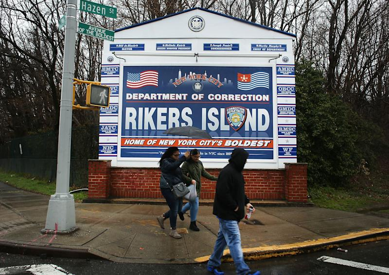 NEW YORK, NY - MARCH 31: People walk by a sign at the entrance to Rikers Island on March 31, 2017 in New York City. New York Mayor Bill de Blasio has said that he agrees with the fundamentals of a plan to close the jail complex on Rikers Island within 10 years. A newly released report from an independent commission, led by Judge Jonathan Lippman and created by the City Council last year, has recommended the closer of the troubled facility. (Photo by Spencer Platt/Getty Images)