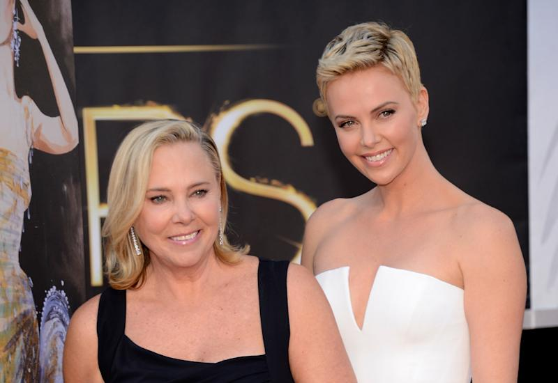 Charlize Theron (right) with her mother, Gerda, at the Oscars in 2013. (Kevin Mazur via Getty Images)