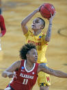 CORRECTS THE DATE TO MARCH 24, NOT MARCH 23 AS ORIGINALLY SENT - Maryland forward Alaysia Styles (5) shoots over Alabama guard Destiny Rice (11) after a steal during the first half of a college basketball game in the second round of the women's NCAA tournament at the Greehey Arena in San Antonio on Wednesday, March 24, 2021. (AP Photo/Ronald Cortes)
