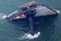 FILE - In this April 18, 2021 file photo, the capsized lift boat Seacor Power is seen seven miles off the coast of Louisiana in the Gulf of Mexico. Volunteers searching for seven men still missing after the oil industry boat capsized on April 13 said they have found life jackets and other debris from the vessel. (AP Photo/Gerald Herbert, File)