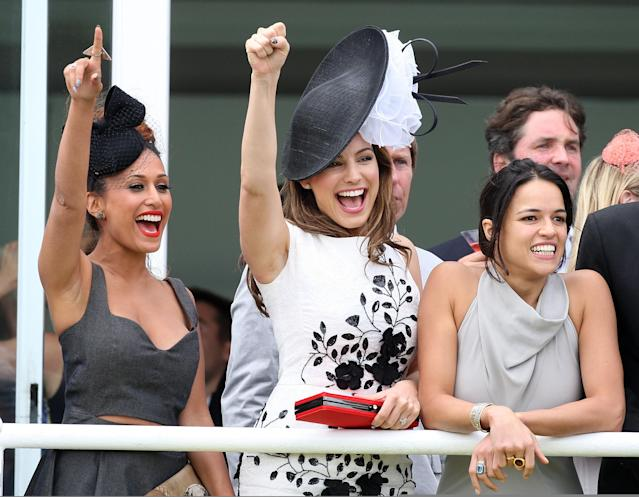 CHICHESTER, ENGLAND - AUGUST 02: (L-R) Preeya Kalidas, Kelly Brook and Michelle Rodriguez watch ladies day at 'Glorious Goodwood' at Goodwood on August 2, 2012 in Chichester, England. (Photo by Danny Martindale/Getty Images)